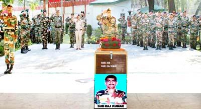 Lt Gen J S Sandhu and all ranks paying tributes to martyr Raj Kumar at Badami Bagh in Srinagar on Monday. (UNI)
