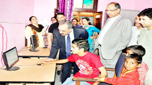 Justice Ali Mohd Magrey and Justice M K Hanjura during visit to Children's Home at R S Pura on Saturday.