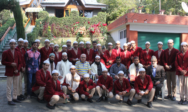 NC leader Dr Farooq Abdullah posing for photograph with students delegation from Poonch at Srinagar.