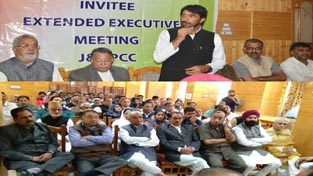 PCC president GA Mir addressing Congress delegates at party convention in Srinagar on Tuesday.