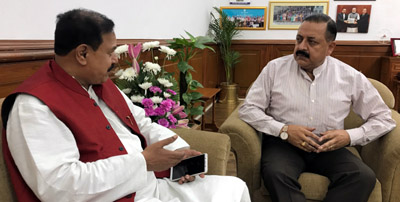 Union Minister Dr Jitendra Singh being briefed about various State related issues by BJP's Sikkim State General Secretary, Shyamal Pal, at New Delhi on Tuesday.