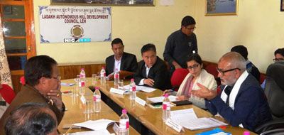 Minister for Public Works, Naeem Akhtar chairing a meeting at Leh on Thursday.