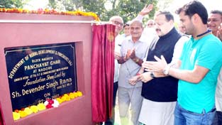NC Provincial President, Devender Singh Rana laying foundation stone of Panchayat Ghar at Nadore.