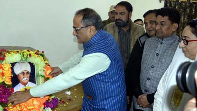 Deputy Chief Minister, Dr Nirmal Singh garlanding the portrait of Pt. Prem Nath Dogra at a function at Srinagar on Tuesday.