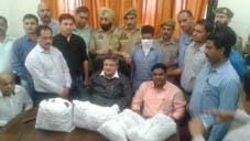Officers of Excise Department and NCB talking to reporters after seizure of charas at Lakhanpur on Thursday.