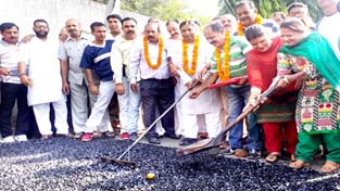 MLA Jammu West and BJP State President Sat Sharma kick starting macdamization of road at Rehari on Sunday. -Excelsior/Rakesh