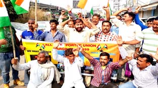 Unemployed Army porters during a protest near Press Club in Jammu. -Excelsior/Rakesh