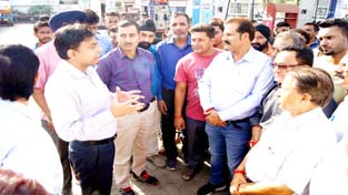 JMC officials interacting with shopkeepers.