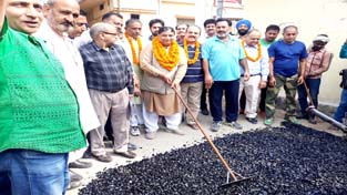 MLA Jammu West, Sat Sharma kick starting macadamization of road in Bakshi Nagar on Sunday.