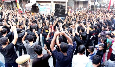 Members of Shia community during a Moharram procession which was taken out in Jammu on Sunday. -Excelsior/Rakesh