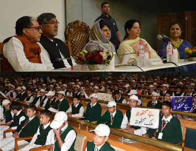 Chief Minister Mehbooba Mufti chairing a function in Srinagar on Monday.