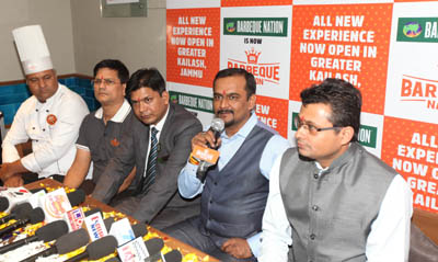 Officials of Barbeque Nation addressing media persons on the opening of its outlet in Jammu.