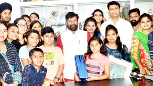 Forest Minister Ch Lal Singh posing with local artists.