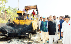 MLA Devender Singh Rana taking stock of macadamization work in Nagrota Assembly Constituency on Sunday.
