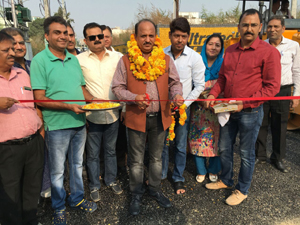 MLA Samba, Dr D K Manyal kick starting blacktopping of road on Monday. — Excelsior/Gautam