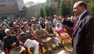 Former minister and JKBT president, Abdul Gani Vakil addressing public meeting at Sopore on Monday.