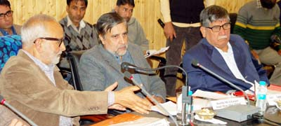 Minister for Public Works, Naeem Akhtar chairing a meeting at Ganderbal on Thursday.