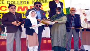 Chief Minister Mehbooba Mufti giving key of scooty to a girl student in Kargil on Saturday.