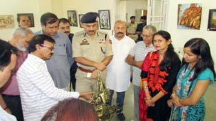 IGP Jammu, Dr SD Singh at an Art Exhibition in Jammu on Monday.