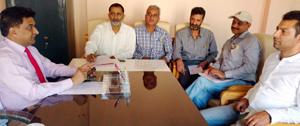 VC, SC, ST, BC Development Corporation Balbir Ram Rattan addressing a meeting of Corporation officers at Srinagar on Tuesday.
