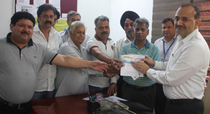 Chairman and members on the Board of Directors of Citizens Cooperative Bank distributing RuPay Debit Cards to clients on Tuesday.