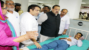 MLA Devender Singh Rana enquiring about health of accident victim in GMC Hospital Jammu on Monday.