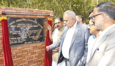 Minister for PHE Sham Lal Choudhary laying foundation stone of water supply scheme in Anantnag.
