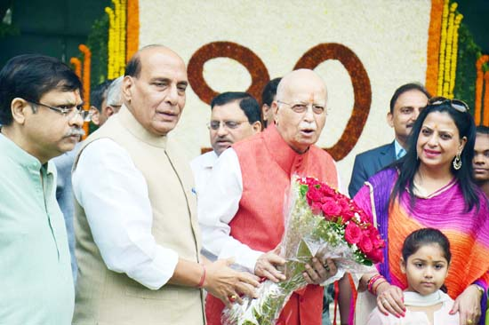 Union Home Minister Rajnath Singh greeting senior BJP leader L K Advani on his 90th birthday, in New Delhi on Wednesday. (UNI)