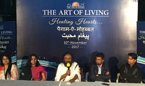 Sri Sri Ravi Shankar addressing victims of Kashmir conflict during a gathering at Bengaluru on Friday.