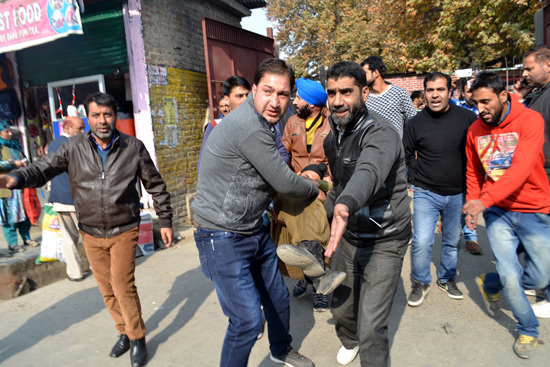 Injured SPO being evacuated to hospital in Anantnag town on Thursday. -Excelsior/Younis Khaliq
