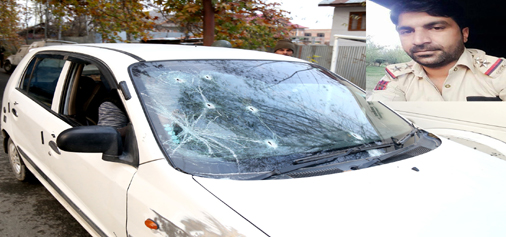 A car damaged in a shoot-out at Zakoora, Srinagar on Friday. (Inset) Imran Tak.  —Excelsior/Shakeel