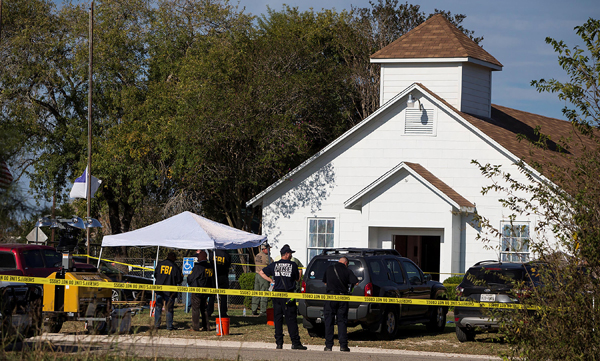 Law enforcement officials investigate a mass shooting at the First Baptist Church in Sutherland Springs, Texas in United States.