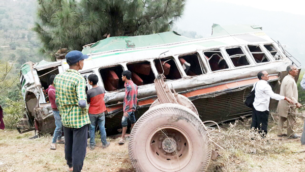 Wreckage of passenger bus which rolled down into gorge near Ramnagar on Tuesday.