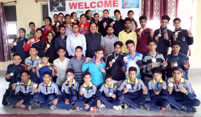Fencers posing along with dignitaries and officials in Reasi.