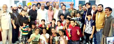 Winners of 27th District Poonch TT Championship posing for a group photograph along with chief guest on Saturday.
