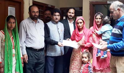 VC, SC, ST, BC Corporation Balbir Ram Rattan handing over loan letters to beneficiaries at Rajouri on Tuesday.
