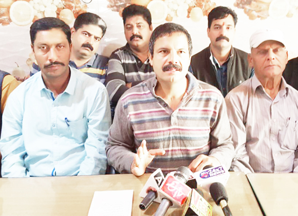 NPP president Balwant Singh Mankotia addressing a press conference at Udhampur on Wednesday.