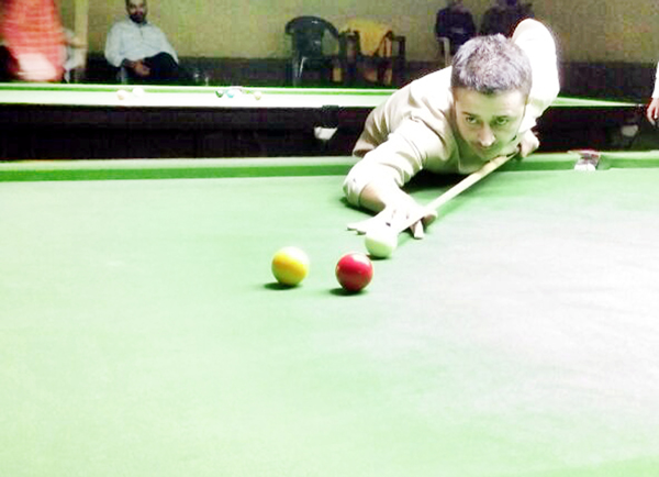 Cueist in action during a semifinal match of State Senior Billiards Championship in Jammu.