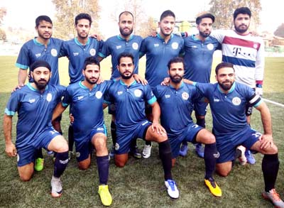 Triumphant players of AG's Football team posing for a group photograph after registering solitary goal win in Srinagar.