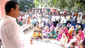MLA Kathua Rajiv Jasrotia addressing a public meeting at Chak Ram Chand Kathua on Friday. -Excelsior/Madan
