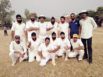 Players of Evershine Cricket Club Jammu posing for a group photograph after entering finals of Veterans Cricket Tournament Akhnoor.