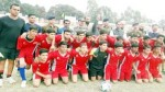 Young footballers posing along with officers and officials at Sports Stadium Kathua.