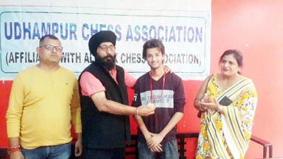 Winner of Udhampur District Open Chess Championship being felicitated by the dignitaries on Sunday.