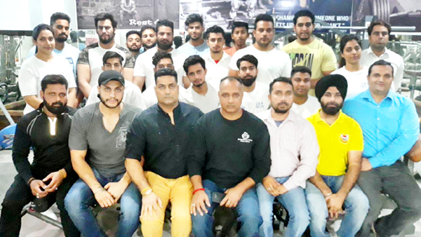 Selected State Power Lifting team posing along with dignitaries and officials after their selection in Jammu on Tuesday.