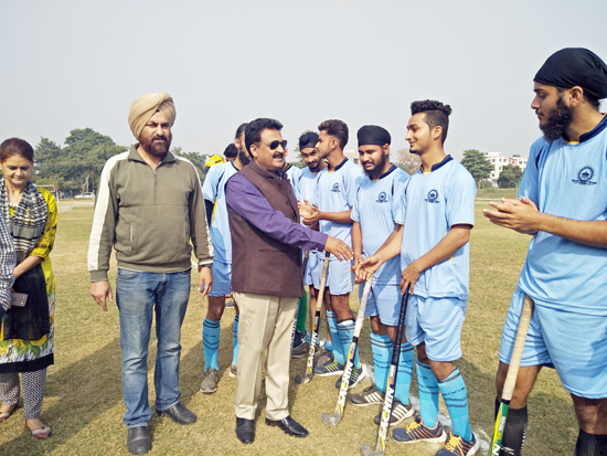 Chief guest interacting with the players during Inter-Collegiate Hockey Tournament at Jammu University on Wednesday.