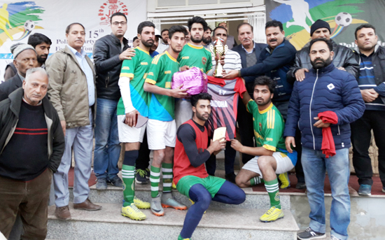 Winners posing for a group photograph along with officials in Srinagar.
