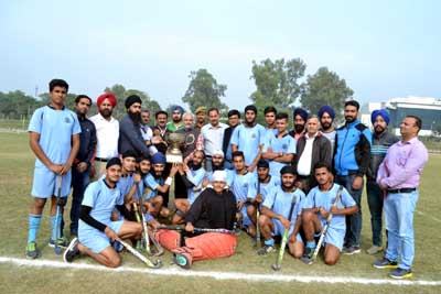 Winners of Hockey Tournament posing along with chief guest and other dignitaries in Jammu.