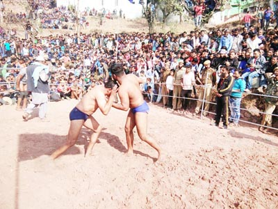 Wrestlers in action during a Wrestling competition organized by Reasi Police on Sunday.