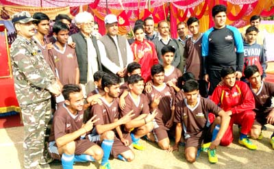 Footballers posing for a group photograph along with chief guest and other dignitaries in Kathua on Saturday.