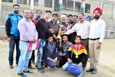 Winners posing along with chief guest and other dignitaries at Jammu University on Friday.